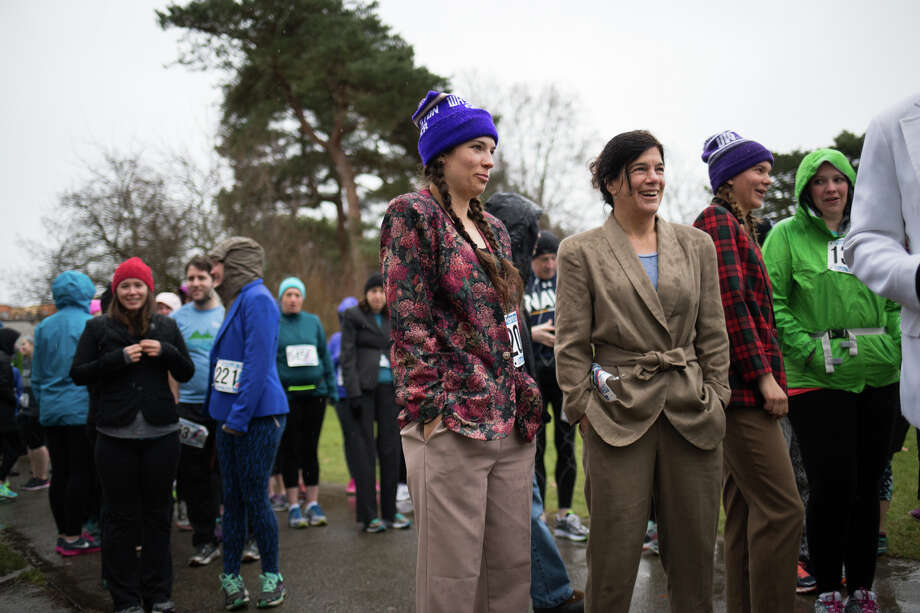 Women wait in line for the start of the Pantsuit 5k Run/Walk at Green Lake on Sunday, Jan. 22, 2017. Photo: GRANT HINDSLEY, SEATTLEPI.COM / SEATTLEPI.COM