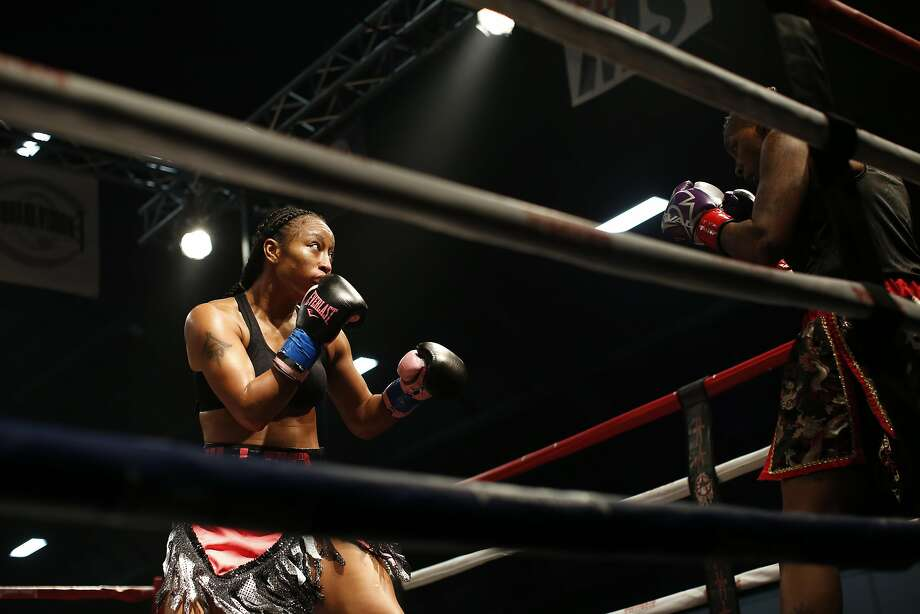 "Raquel ""Pretty Beast"" Miller, left, fights Latasha ""Da Future"" Burton, right, Saturday January 21, 2017 at the Alameda County Fairgrounds. Miller won the match. Photo: Kathleen Duncan / The Chronicle"