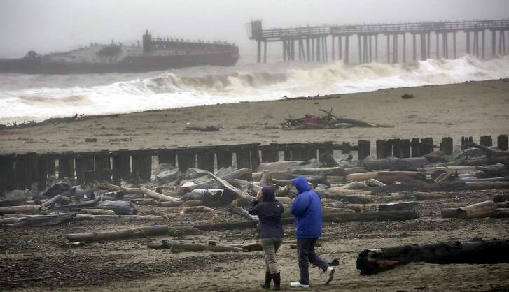 Storm waves batter the cement ship at Seacliff State Beach on Wednesday, Jan. 4, 2017, in Aptos, Calif. Wet winter weather slammed much of the West on Wednesday. (Shmuel Thaler/The Santa Cruz Sentinel via AP)