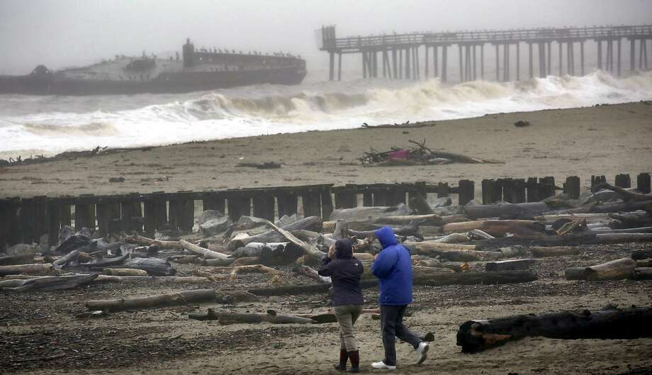 Storm waves batter the cement ship at Seacliff State Beach on Wednesday, Jan. 4, 2017, in Aptos, Calif. Wet winter weather slammed much of the West on Wednesday. (Shmuel Thaler/The Santa Cruz Sentinel via AP) Photo: Shmuel Thaler, Associated Press