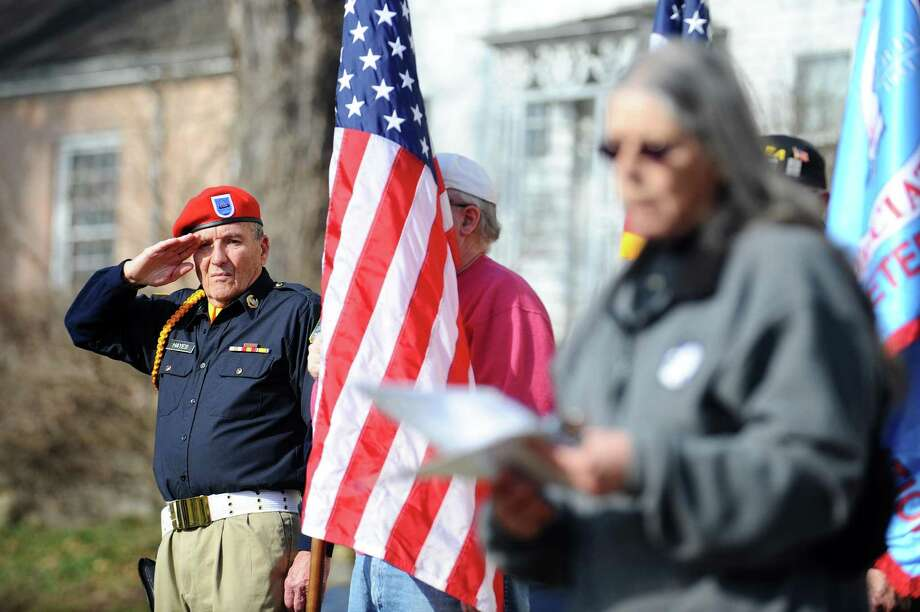 Don Hayes, of New Milford, salutes as the names of prisoners of war are read during the 32nd annual bell-ringing ceremony outside the St. Francis Xavier parish center in New Milford, Conn. on Sunday, Jan. 22, 2017. Photo: Michael Cummo / Hearst Connecticut Media / Stamford Advocate