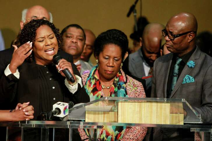 Congresswoman Sheila Jackson Lee, center, summoned Houston community leaders Sunday to pray for unity and for the healing of wounds of division created during the most recent elections.