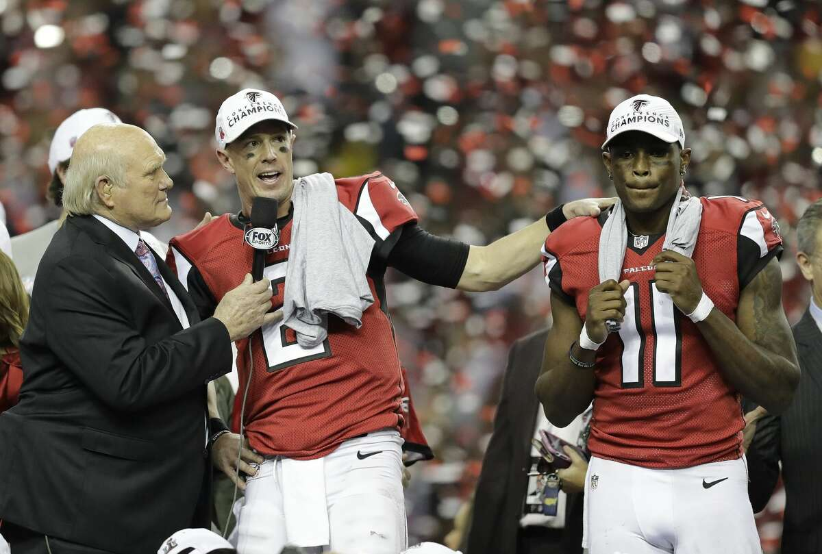 Former NFL player and sports broadcaster Terry Bradshaw interviews Atlanta Falcons' Matt Ryan (2) and Julio Jones after the NFL football NFC championship game against the Green Bay Packers, Sunday, Jan. 22, 2017, in Atlanta. The Falcons won 44-21 to advance to Super Bowl LI. (AP Photo/David Goldman)