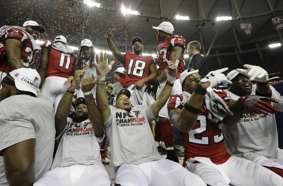 Atlanta Falcons players celebrate after the NFL football NFC championship game against the Green Bay Packers Sunday, Jan. 22, 2017, in Atlanta. The Falcons won 44-21 to advance to Super Bowl LI. (AP Photo/David J. Phillip)