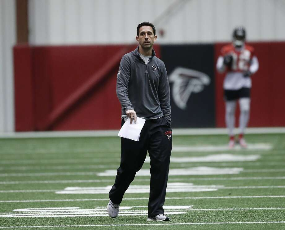 Atlanta Falcons offensive coordinator Kyle Shanahan walks on the field during an NFL football practice , Thursday, Jan. 19, 2017, in Flowery Branch, Ga.. TheFalcons will face the Green Bay Packers in the NFC Championship on Sunday in Atlanta. (AP Photo/John Bazemore) Photo: John Bazemore, Associated Press