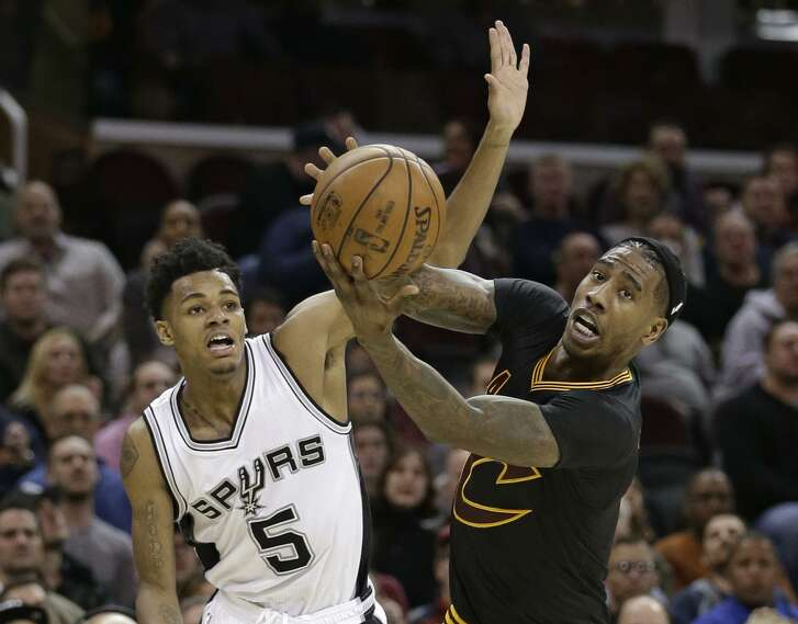 Rookie Dejounte Murray (left), starting in place of Tony Parker, had 14 points and six assists in the Spurs' victory at Cleveland.