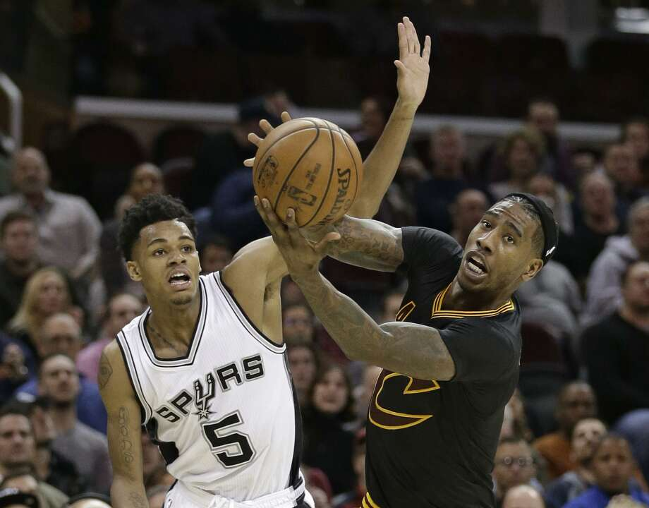 Rookie Dejounte Murray (left), starting in place of Tony Parker, had 14 points and six assists in the Spurs' victory at Cleveland. Photo: Tony Dejak / Associated Press / AP 2017