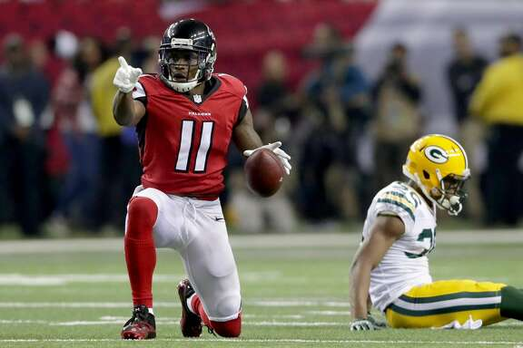 ATLANTA, GA - JANUARY 22:  Julio Jones #11 of the Atlanta Falcons signals a first down in the third quarter against the Green Bay Packers in the NFC Championship Game at the Georgia Dome on January 22, 2017 in Atlanta, Georgia.  (Photo by Streeter Lecka/Getty Images)