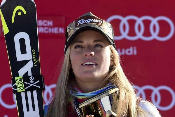 Switzerland's Lara Gut stands on the podium after winning an alpine ski, women's World Cup super-G, in Garmisch-Panterkirchen, Germany, Sunday, Jan. 22, 2017. (AP Photo/Marco Tacca)