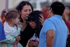 Family members reunite after exiting Rolling Oaks Mall,   Sunday, Jan. 22, 2017 following a shooing inside the mall.