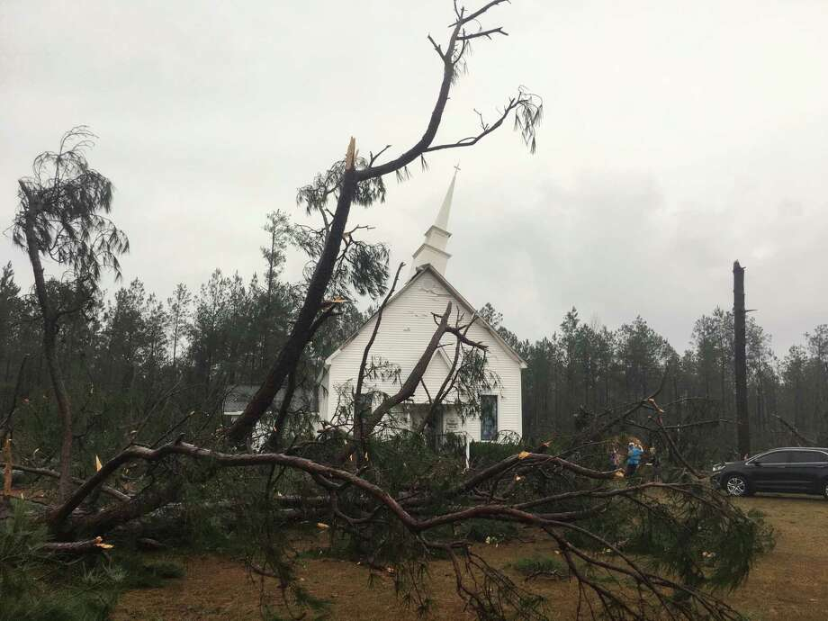 "Fallen trees sit near Zoar United Methodist Church that sustained damage to its steeple Sunday, Jan. 22, 2017, near Baxley, Georgia. The National Weather Service said Sunday that southern Georgia, northern Florida and the corner of southeastern Alabama could face ""intense and long track"" tornadoes, scattered damaging winds and large hail. (AP Photo/Lewis Levine) Photo: Lewis Levine, FRE / AP"