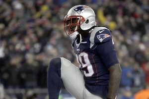 New England Patriots running back LeGarrette Blount reacts after a touchdown run during the second half of the AFC championship NFL football game against the Pittsburgh Steelers, Sunday, Jan. 22, 2017, in Foxborough, Mass. (AP Photo/Steven Senne)
