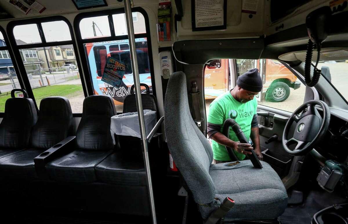 Jessie Jackson, a mechanic's helper at the Houston Wave, details a bus Wednesday, Jan. 4, 2017, in Houston. ( Jon Shapley / Houston Chronicle )