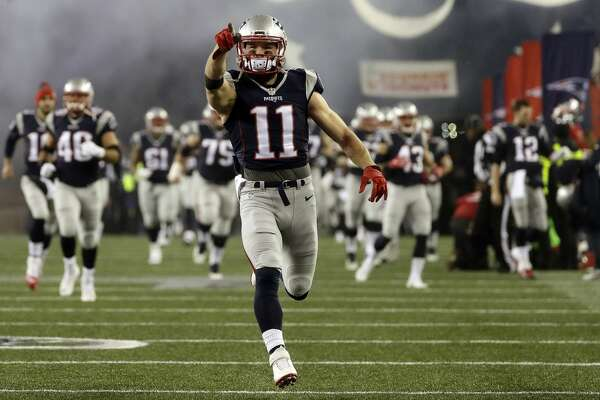 New England Patriots wide receiver Julian Edelman leads his team onto the field for the AFC championship NFL football game against the Pittsburgh Steelers, Sunday, Jan. 22, 2017, in Foxborough, Mass. (AP Photo/Matt Slocum)