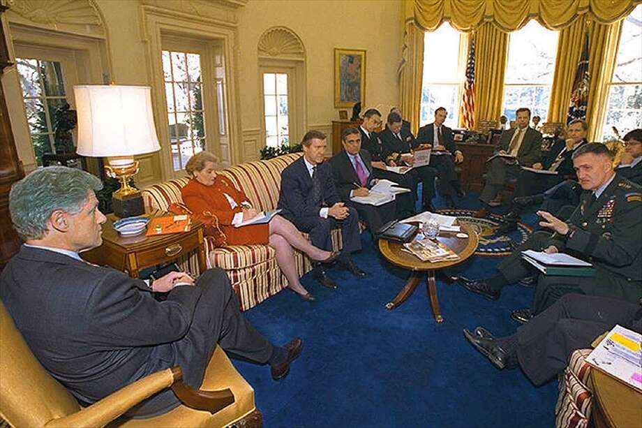 president in oval office. us president bill clinton l meets with his national security team in oval office c