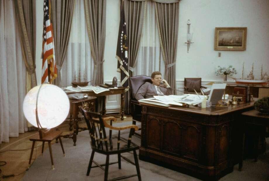 oval office. american president john fitzgerald kennedy 1917 1963 smiles as he speaks on the oval office