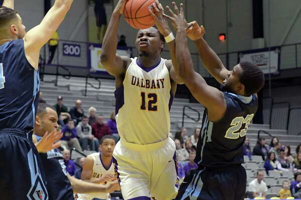 Devonte Campbell of UAlbany grabs a rebound during their game against Maine on Sunday, Jan. 22, 2017, in Albany, N.Y.   (Paul Buckowski / Times Union)