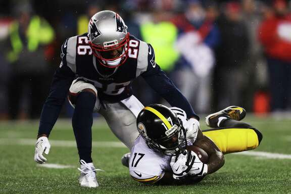 FOXBORO, MA - JANUARY 22: Eli Rogers #17 of the Pittsburgh Steelers is tackled by Logan Ryan #26 of the New England Patriots during the second quarter in the AFC Championship Game at Gillette Stadium on January 22, 2017 in Foxboro, Massachusetts.