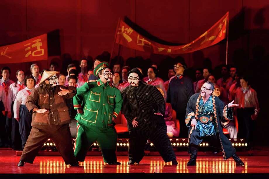 "Houston Grand Opera's production of ""Nixon in China."" Patrick Carfizzi, left, portrays an evil Chinese landlord with a Fu Manchu mustache. Photo: Lynn Lane / Lynn Lane"