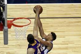 DALLAS, TX - JANUARY 22:  Justin Anderson #1 of the Dallas Mavericks takes a shot against Ivica Zubac #40 of the Los Angeles Lakers at American Airlines Center on January 22, 2017 in Dallas, Texas.  NOTE TO USER: User expressly acknowledges and agrees that, by downloading and or using this photograph, User is consenting to the terms and conditions of the Getty Images License Agreement.  (Photo by Ronald Martinez/Getty Images) ORG XMIT: 662354969