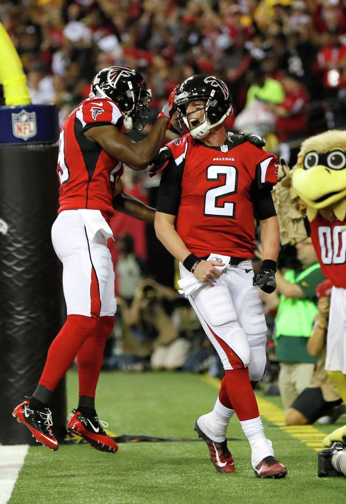 ATLANTA, GA - JANUARY 22: Matt Ryan #2 of the Atlanta Falcons celebrates with Aldrick Robinson #19 after a 14 yard touchdown run in the second quarter against the Green Bay Packers in the NFC Championship Game at the Georgia Dome on January 22, 2017 in Atlanta, Georgia. (Photo by Kevin C. Cox/Getty Images)
