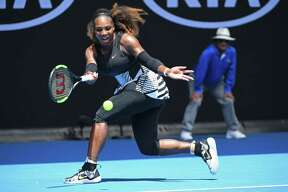 Serena Williams of the US hits a return against Czech Republic's Barbora Strycova during their women's singles fourth round match on day eight of the Australian Open tennis tournament in Melbourne on January 23, 2017. / AFP PHOTO / WILLIAM WEST / IMAGE RESTRICTED TO EDITORIAL USE - STRICTLY NO COMMERCIAL USEWILLIAM WEST/AFP/Getty Images