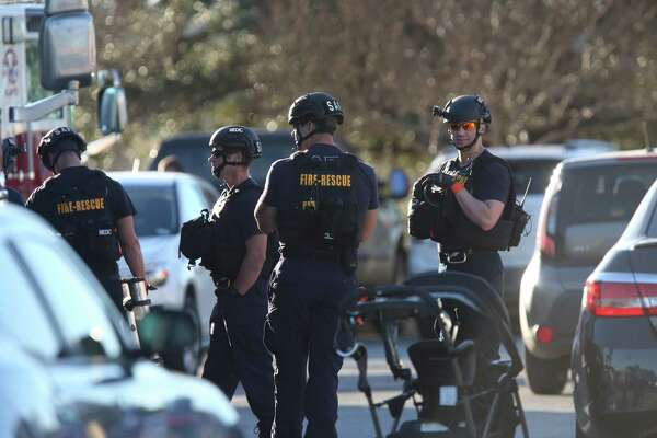 Law enforcement personnel work the scene of a shooting at Rolling Oaks Mall Sunday, Jan. 22, 2017.