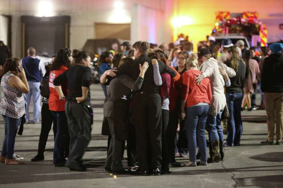 Employees and shoppers are released as law enforcement personnel work the scene of a shooting at Rolling Oaks Mall Sunday, Jan. 22, 2017. According to San Antonio Police Chief William McManus, two suspects attempted a jewelry store robbery and two good samaritans attempted to intervene. One of the samaritans was shot dead by one of the suspects. One of the suspects got away shooting six people inside the mall. Photo: Jerry Lara, Staff / San Antonio Express-News / 2017 San Antonio Express-News