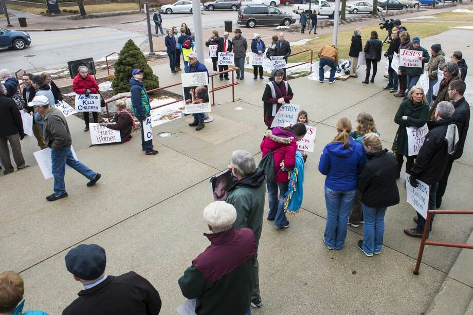 Participants gather on the Midland County Courthouse steps at the Roe v. Wade Memorial Prayer Vigil hosted by Right to Life of Midland County on Sunday. It was the 44th anniversary of the Roe v. Wade decision. Photo: DANIELLE McGREW TENBUSCH | For The Daily News