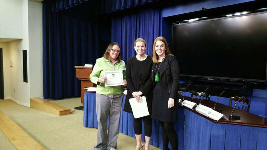 Photo Provided: L-R, Alison Ginter,  Delta College Campus Life and Student Engagement Coordinator, displays the certificate she was presented during a recent ceremony as part of Healthy Challenge  Day at the White House. Also pictured is Kristie Canegallo (center), assistant to the president and deputy chief of staff for implementation, and Zekie Salman, a AmeriCORP Vista member who accompanied Ginter on the trip to the nation's capital. Ginter and Delta received the special recognition for their successful efforts in the White House's Healthy Campus Challenge that aimed to get colleges--especially community colleges--across the country engaged in getting uninsured people to sign up for insurance through the Health Insurance Marketplace.