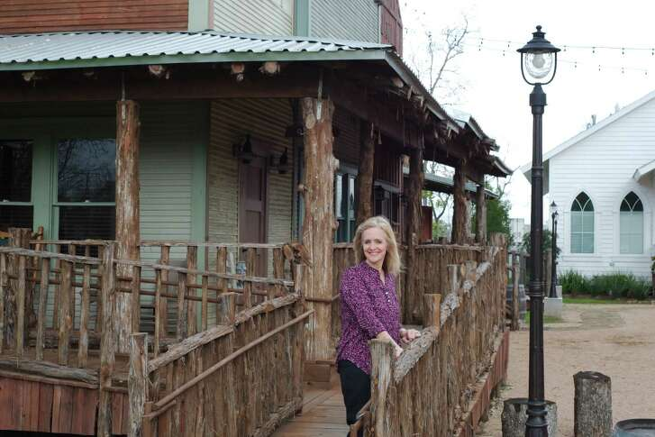 Old-town western style buildings give the six acre office complex a rustic feel in the background as developer Jackie Spingener poses for a photo in Pasadena Wednesday, Jan. 18.