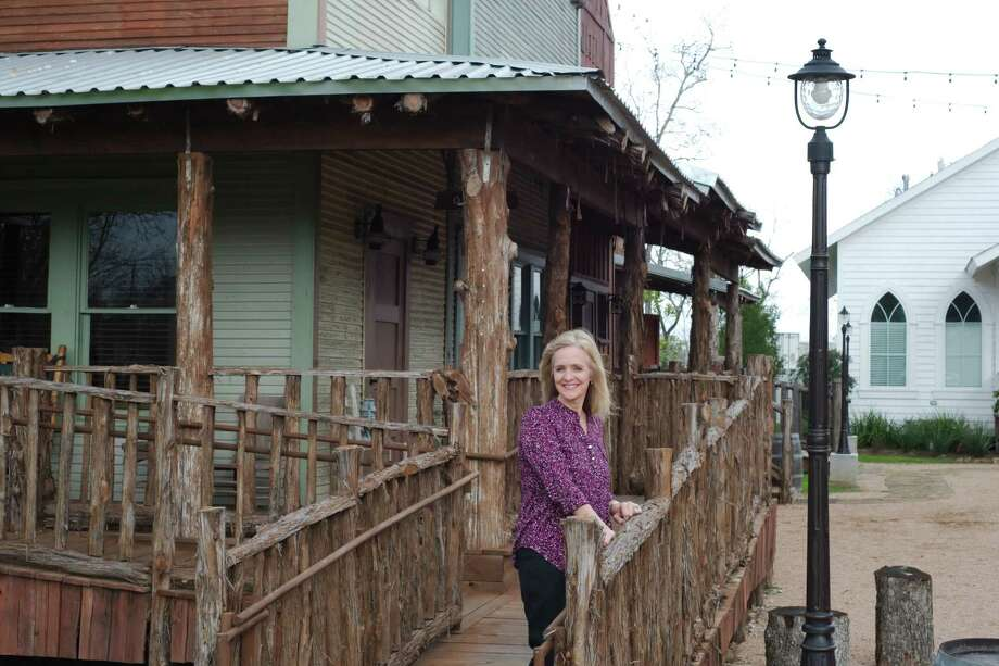 Old-town western style buildings give the six acre office complex a rustic feel in the background as developer Jackie Spingener poses for a photo in Pasadena Wednesday, Jan. 18. Photo: Kirk Sides / © 2016 Kirk Sides / Houston Community Newspapers