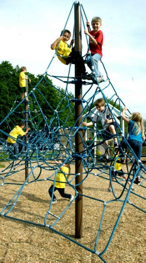 SPECTRUM/Brandon Allen, left, and Ben Randolph, both second-grade students at Hill and Plain School, frolic on a climbing facility at the new playground along Pickett District Road in New Milford, May 22, 2010. Photo: Norm Cummings / The News-Times