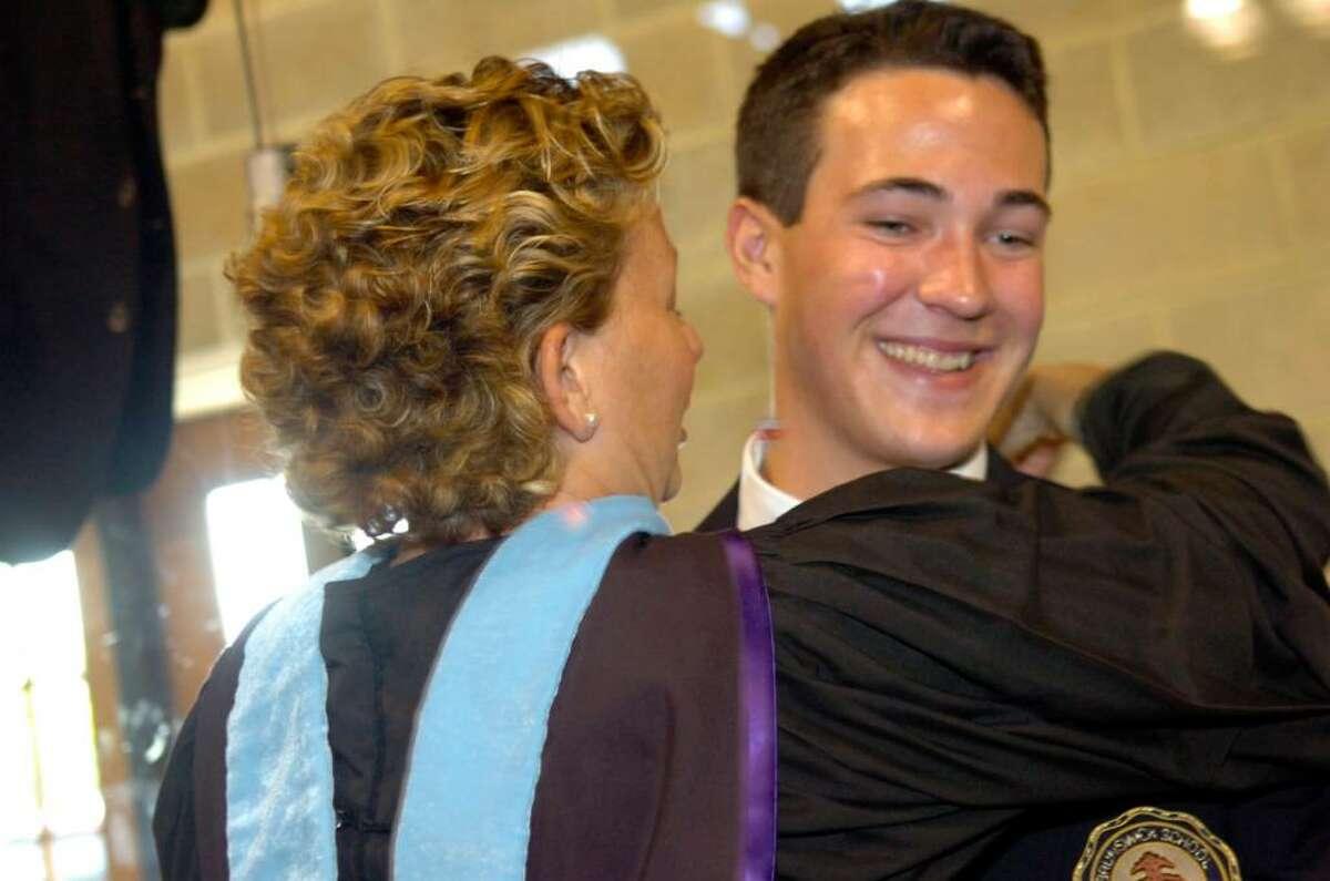 Graduate Brendan Gilbert gets a hug from his fourth grade teacher Jennifer Spaulding before Brunswick School graduation on Wednesday, May 26, 2010.