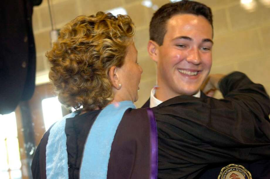 Graduate Brendan Gilbert gets a hug from his fourth grade teacher Jennifer Spaulding before Brunswick School graduation on Wednesday, May 26, 2010. Photo: Helen Neafsey / Greenwich Time