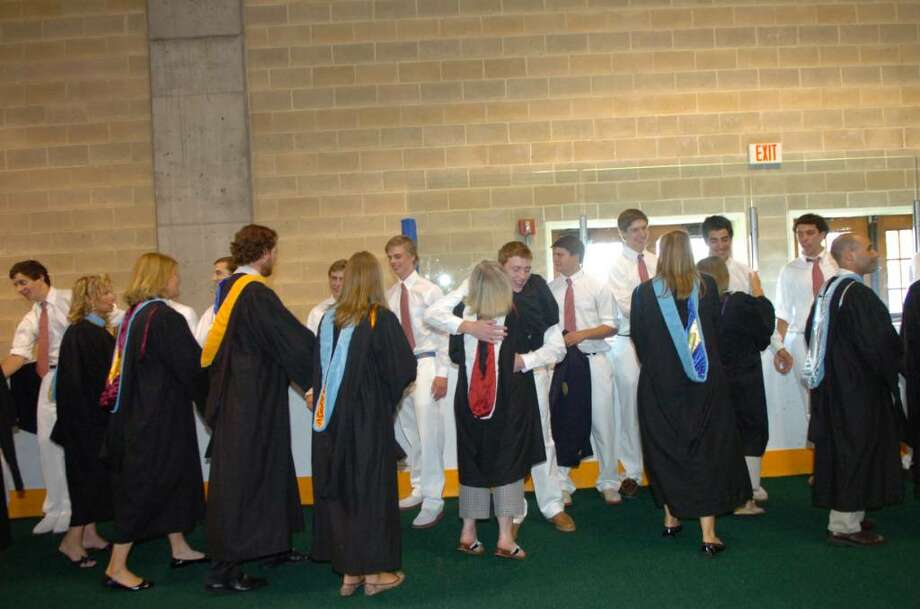 Before the Brunswick School graduation begins, the faculty congratulates the class of 2010 on Wednesday, May 26, 2010. Photo: Helen Neafsey / Greenwich Time