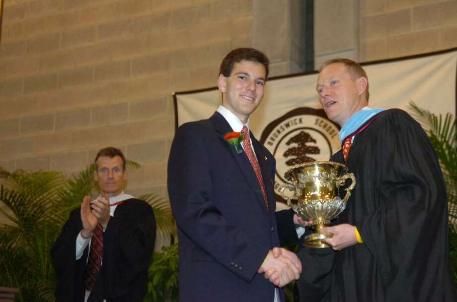 Brunswick School graduate Samuel Ruchman winning the Kulukundis Cup, for the senior with the highest academic standing for the year, presented by Richard Beattie, Dean of Academic Affairs, Upper School Associate Director of College Guidance, and instructor of history, on Wednesday, May 26, 2010. At left is Headmaster Thomas Philip. Photo: Helen Neafsey / Greenwich Time