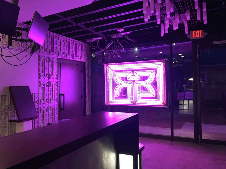 Picture yourself as Harrison Ford in Blade Runner, on a selfie-ready stool with a newspaper in front of the neon logo installation at the new Rice Box in the Heights. Photo: Alison Cook, Houston Chronicle