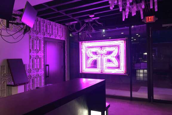 Picture yourself as Harrison Ford in Blade Runner, on a selfie-ready stool with a newspaper in front of the neon logo installation at the new Rice Box in the Heights.