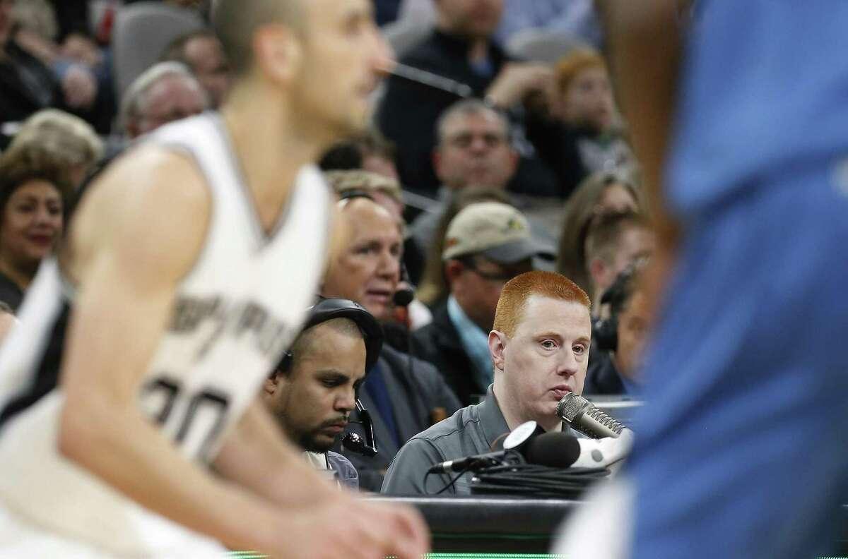 Spurs public-address announcer Jonathan Sanford works the game against Minnesota on Jan. 17.