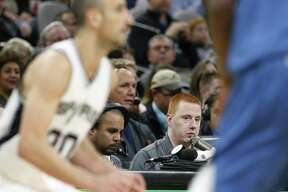 Spurs public-address announcer Jonathan Sanford works the game against Minnesota on Jan. 17.
