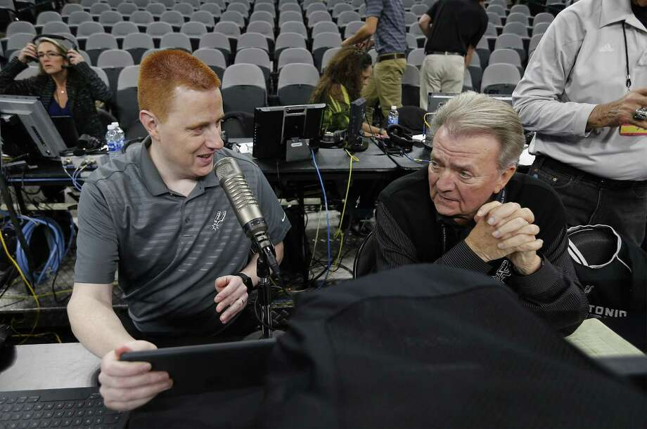 Jonathan Sanford (left) chats with Spurs game statistician Bill Mochel before tipoff against the Timberwolves at the AT&T Center. Photo: Kin Man Hui /San Antonio Express-News / ©2017 San Antonio Express-News