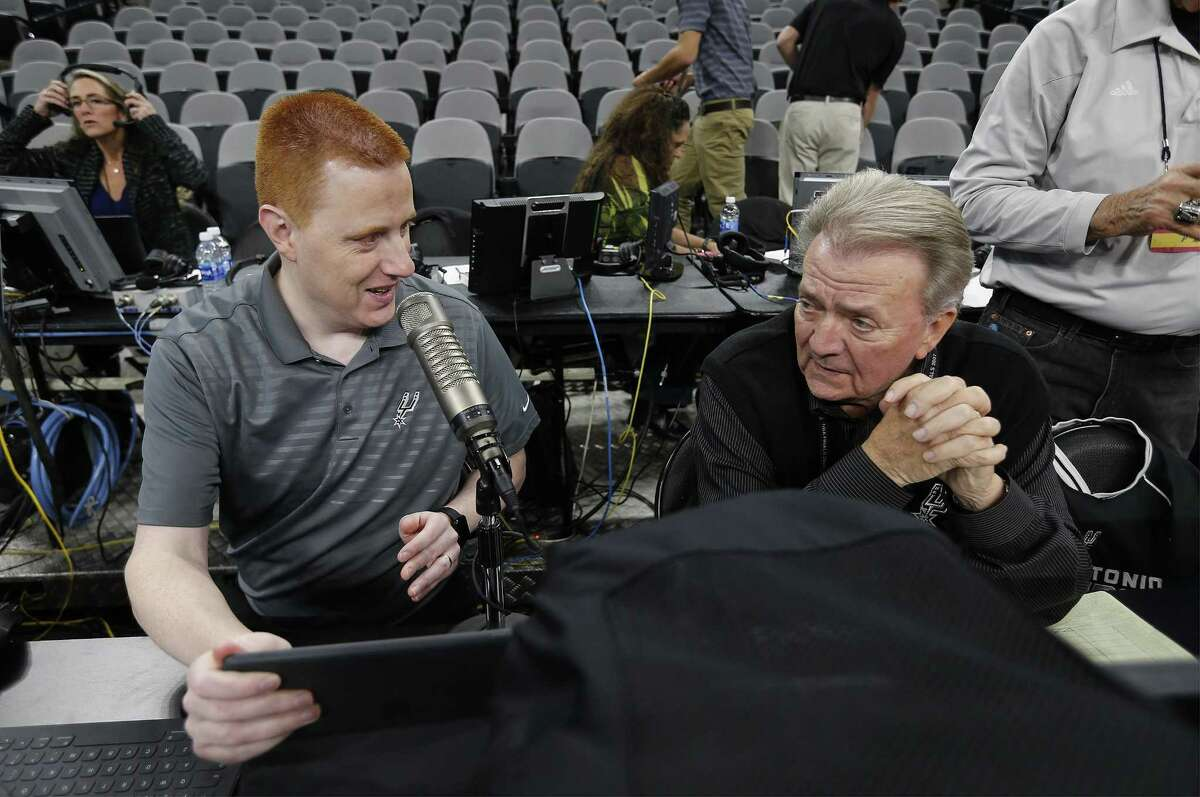 Spurs Announcer Jonathan Sanford (left) chats with game statistician Bill Mochel before the Spurs game against the Minnesota Timberwolves at the AT&T Center on Tuesday, Jan. 17, 2017.