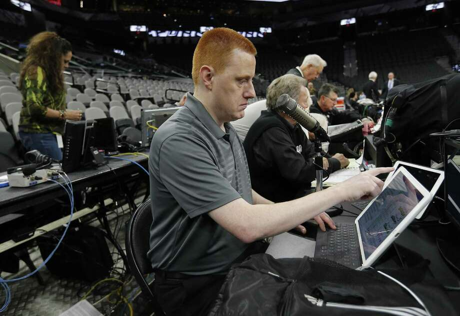 Spurs announcer Jonathan Sanford gets ready for work before the game against the Minnesota Timberwolves at the AT&T Center on Jan. 17, 2017. Photo: Kin Man Hui /San Antonio Express-News / ©2017 San Antonio Express-News