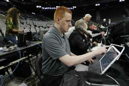 Spurs announcer Jonathan Sanford gets ready for work before the game against the Minnesota Timberwolves at the AT&T Center on Jan. 17, 2017.