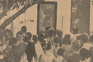 """Persons from among all age gropus press close to the back screen door Monday of the C.P. Bass home, 816 Ave. C in Port Neches, to see a likeness of the head profile of Jesus Christ. The image's chin is just above the head of a youth in the center. The hair of the likeness is long and curves downward to the left."" Enterprise staff photo by John Snell. Published June 17, 1969 The appearance of Jesus Christ's profile on a screen door at 816 Ave. C, Port Neches, in 1969, brought thousands of visitors to Mid-County."