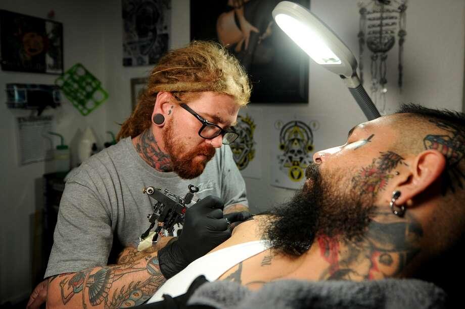 James Hiebe tattoos Eloy Perez on Tuesday, Jan. 12, 2017, at The Body Gallery.  James Durbin/Reporter-Telegram Photo: James Durbin