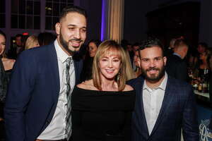 "Marwin Gonzalez, from left, Janet Gurwitch and Jose Altuve at the Houston Astros Foundation's second annual ""Diamond Dreams"" gala. (For the Chronicle/Gary Fountain, January 20, 2017)"