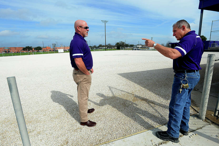 Port Neches - Groves' district Maintenance Director Jeff Bergeron (right) talks with Superintendent Dr. Rodney Cavness as they take a look at the prepped softball field. Construction crews are continuing work on laying astroturf on the baseball and softball fields at Port Neches - Groves' ball park. Both the softball and baseball fields are being renovated to have turf on field. Though heavy rainfall last month delayed the work, the projects are expected to be completed in time for season opening scrimmages within the next two weeks. The district's maintenance department have been joining in the work, allowing them to save enough money to make additional updates, including needed repairs to the masonry surrounding the field and in the dugouts, and new fencing and score boards will be in place ahead of schedule, as well. The dual-field project entailed 4500 tons of large rock, 220 tons of small rocks, and 70 massive rolls of astroturf. Photo taken Friday, January 20, 2017 Kim Brent/The Enterprise Photo: Kim Brent / Beaumont Enterprise