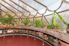 The circular greenhouse at Tirranna was built after iconic architect Frank Lloyd Wright's death by one of his early apprentices - William Wesley Peters, chief architect of Taliesin Associated Architects, a firm founded by Wright and it replicates windows at the Guggenheim Museum.